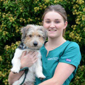 Grace Lane Vet team member Isobel Dwyer headshot with terrier