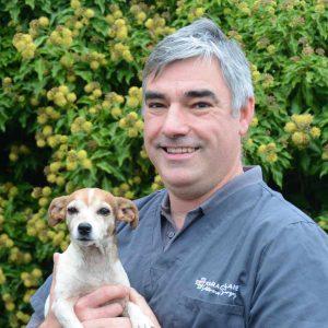 Grace Lane Vet team member John Whitwell headshot with little lap dog